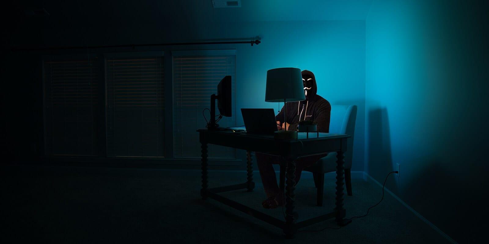 Man in the dark on computer - Password hacking